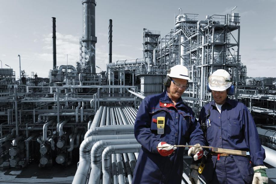 refinery workers inside oil and gas installation